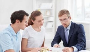 mf business person meeting young couple paperwork