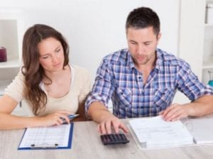 wf young couple caculator and paperwork